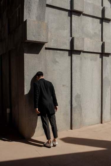 man hitting head on wall