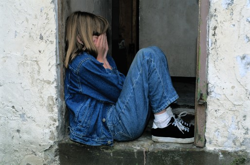 child_sitting_jeans_in_the_door_cry_sad_lonely_scared_hands_on_face-1180647
